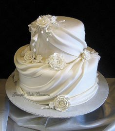 Elegant White Fondant Wedding Cake with Sugar Flowers and Swags by Graceful Cake Creations, via Flickr