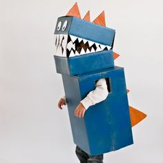 Raww! Make this easy cardboard dinosaur costume out of 3 boxes and some paint.