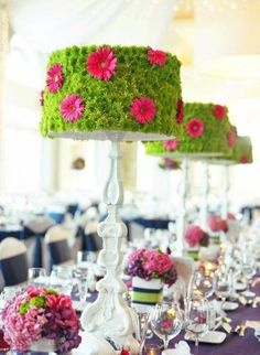 "This made me think; we could place dessert cupcakes on stands in middle of tables for ""etible"" centerpieces. Not: Lamps flower bedecked unusual centerpiece"