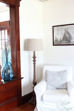 White walls, dark wood and shimmering thoughts of the sea meet in our living room.