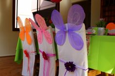 I like kid decorations that can do double duty. These dollar store fairy wings used to dress the table can also be used as party favors.