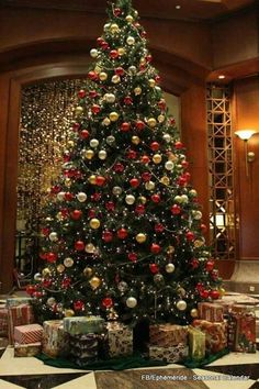 Traditional Christmas tree with many presents