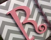 Use a canvas, cover in fabric, and paint wooden letters to match room decor...love chevron!