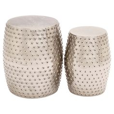 Perfect for displaying lush potted plants or as chic side tables, this stylish metal stool set showcases pierced designs.  Product: ...
