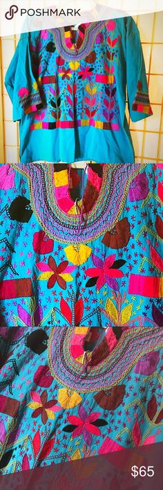 """New Mexican Handmade Embroidered Blouse Turquoise Gorgeous Mexican Embroidered Blouse 100% Handmade in Chiapas, Mexico. The design features a rural scene that represents stars in the sky and corn plants. New. One-of-a-Kind unique top! Wear art! Armpit to armpit 23"""" Lenght 26"""" Cielito Lindo Tops Blouses"""