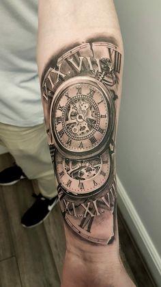 ##tatuaje de reloj para hombre en el brazo