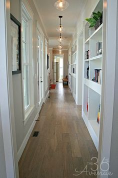 Love this hallway with those lights!! Home Decor and Design Tips that never fail at the36thavenue.com