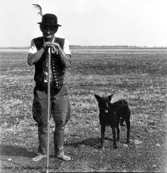 Barefoot shepherd with hat and Mudi, Pentezug Hortobágy, Hungary. Ph. by Csongrady Márta
