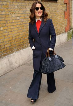 Salma Hayek. Smarten up this season's denim flares with a shirt, jumper and long blazer coat. Get daily outfit inspiration with our round-up of the best A-list casual looks | Stylist Magazine
