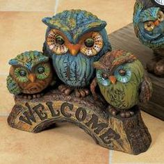 WELCOME OWLS ON LOG.. Totally have this, only mine in not colorful, all neutral brown