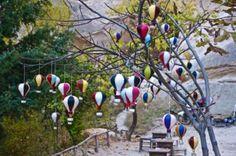 Hot-air balloons hang from tree in Cappadocia, Turkey trueworldtravels.com