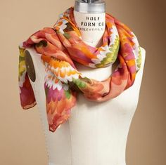 """Sunset shades and 60s flowers recall the summer of love in a soft scarf to wear as your stylish whim dictates. Polyester. Hand wash. Imported. 45""""W x 72""""L."""