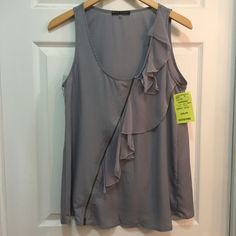 Pure Sugar Gray Ruffled Top with Zipper Accent NWT Gray Racerback with zipper and ruffled accents in front. New with tags. 100% polyester. Size Medium. Also carrying the same top in Small in another listing. Pure Sugar Tops Tank Tops