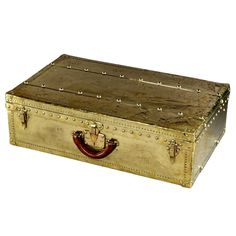 """Louis Vuitton All-Brass 'Explorer's Suitcase', c. 1910.  An extremely rare, large suitcase completely covered with brass  sheeting, corners, latches, LV studs and leather handle to survive inhospitable climates and heavy use.  6' 2"""" x 46"""" x 23"""" - obviously for someone who traveled with a porter!"""