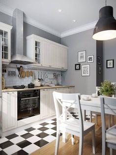 Любопытное сочетание современного стиля и элементов стиля прованс представлено в кухне от Дениса Красикова. Зона приготовления пищи обозначена черно-белой