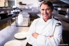 Smiling chef holding ladle in the kitchen Chef Jackets, Pictures, Royalty Free Images