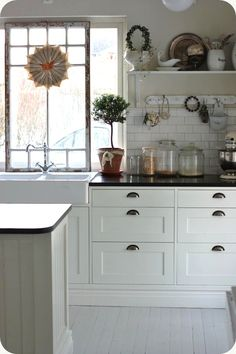 subway tile. open shelf. I am liking the vintage window in front of the replacement.