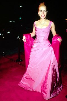 Kate Winslet, 1996  Pink-on-pink Vivienne Westwood? No wonder Kate looks so delighted. #refinery29 http://www.refinery29.com/2015/02/82170/best-oscar-red-carpet-photos#slide-2