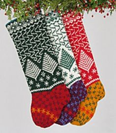 SNOW STORM, a winter-scene concoction of eye-catching color, adds a bit of whimsy to a grouping of like-minded stockings.