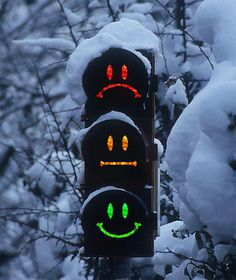 COOL CAR STUFF - Great traffic light. How come I always get caught at the unhappy face? Especially, when I'm in a hurry.