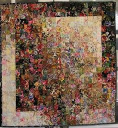 This is a Watercolor Quilt...I can not think how one picks the fabric for such a work of art...my brain just does not seem to grasp this technique...