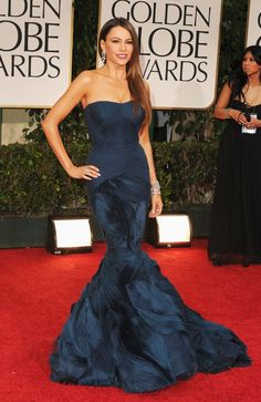 "2012 Golden Globes - The ""Modern Family"" siren accentuated her fabulous physique in a form-fitting teal gown by Vera Wang. Loose tresses and more than five million $  worth of Harry Winston jewels completed Vergara's va-va-va voom look. - ""She looked beautiful! Love the dress and color."""