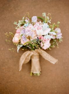 bridal bouquet assorted flowers including wildflowers wrapped in burlap wrapped all