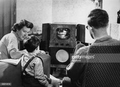 A family watching television at home.