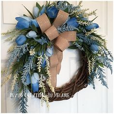 This blue and cream spring grapevine wreath is the perfect addition to your spring decor. It is simple yet absolutely beautiful at the same time. The blue tulips paired with blue and cream wispy filler stems are the perfect combination for to take you from spring to summer. The