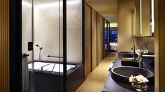 Cherry Blossom design full marble bathroom with combined bathtub and rainforest shower await.