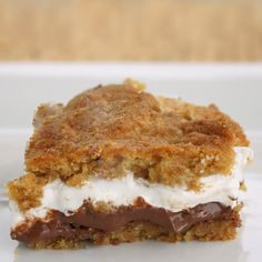 A yummy graham cracker crust with a thick layer of chocolate and oozing marshmallow.