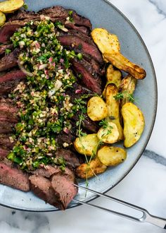 Grilled Flank Steak and Fingerlings with Chimichurri | www.kitchenconfidante.com |   Fire up the grill with this simple, tender flank steak, topped with a chunky chimichurri sauce!