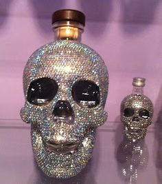 Fabulous Crystal Head Vodka Skull Bottle Covered in Glass Crystals.  Colour of the crystals is Crystal AB, which reflects a stunning ra...