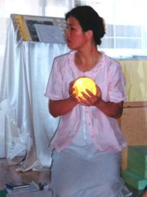 One of our Asian representatives holding a Saturn Bubbler Sphere, during a Bubbler installation in Singapore. These installation gatherings are profound and wondrous.