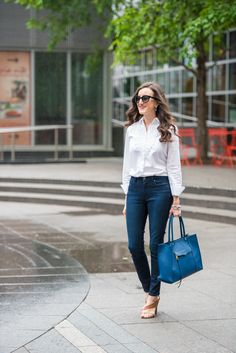 Classic style outfits. Wearing skinny jeans with a white button down shirt. A casual and elegant work outfit! http://baublestobubbles.com/2017/05/08/classic-style-outfit-ideas/?utm_campaign=coschedule&utm_source=pinterest&utm_medium=Olivia%20Johnson%20-%20Baubles%20to%20Bubbles&utm_content=Casual%20Sophistication