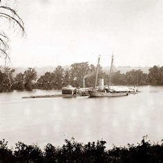 James River, Virginia. U.S. monitor Canonicus taking on coal from a schooner.