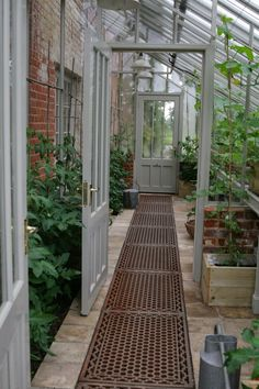 Love this greenhouse idea for off the back of the house. Use an old door for tre. - Love this greenhouse idea for off the back of the house. Use an old door for trellis. Greenhouse Attached To House, Outdoor Greenhouse, Lean To Greenhouse, Greenhouse Plans, Greenhouse Wedding, Cheap Greenhouse, Greenhouse House, Pallet Greenhouse, Greenhouse Gardening