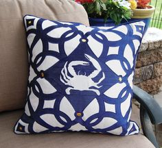 Presenting the Blue and White Moroccan Crab Pillow in a crisp and classic navy and white collection made from fade resistant, mildew resistant and moisture-wicking outdoor solution dyed acrylic.Luxur