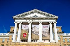 Banners celebrating 100 years of the Wisconsin Idea adorn the exterior of Bascom Hall at the University of Wisconsin-Madison on Aug. 5, 2011.