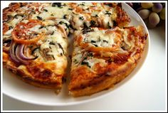 Homemade pizza is so easy and so inexpensive, it's a wonder why more people don't make it themselves. We like a thin crust pizza, but w...