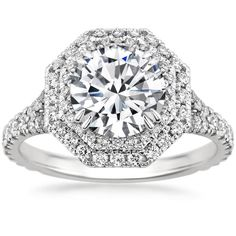 Two sparkling octagonal halos embrace the center gemstone in this exceptional ring. The alluring split shank design features pavé-set diamonds extending to a small sizing bar in the back.