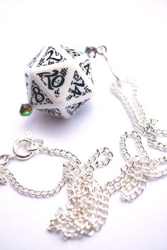 D20 White Dice Necklace on Silver Chain. via Etsy