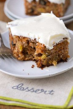 The BEST Carrot Cake is quick, easy and cake fully loaded with pineapple, coconut, walnuts and raisins and all topped off with cream cheese frosting.