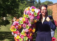 Blossom In Hugs the walkabout flower man with flower power!  Hugging, dancing and adorable greeting your guests and mingling in full bloom.  Perfect for many these inc Alice in Wonderland, Summer Garden parties and weddings.