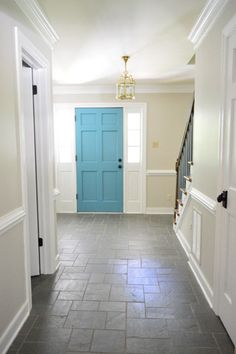 "Foyer Freshness from Young House Love: Benjamin Moore Edgecomb Gray eggshell walls and Simply White semigloss trim. Sherry describes Edgecomb Gray as ""one part sand and one part greige"" appearing alternately as light platinum and as coffee with lots of milk swirling in it!"