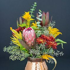 Make your own fall floral arrangement with this flower recipe! Bonus if you have gorgeous copper containers like these!