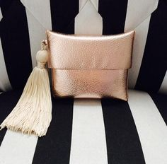 Caterina metallic clutch with tassel