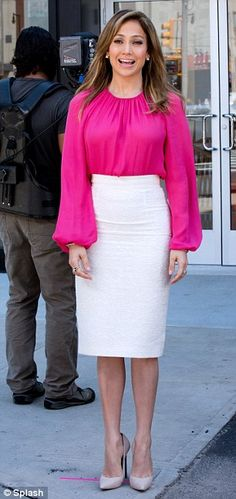 Dressed to impress: Jennifer teamed the skirt with a hot pink top and towering nude heels