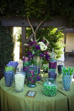 Purple and green candy bar, great for peacock wedding theme..indeed (-: