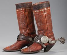 Tom Mix's Personal Cowboy Boots. Sold $5,175 and Bob Baldwin Canon City Spurs made for Tom Mix. Est. Sold $16,100